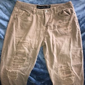 Tan ripped skinny jeans